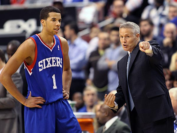 Sixers rookie point guard Michael Carter-Williams and coach Brett Brown. (H. Rumph Jr/AP)