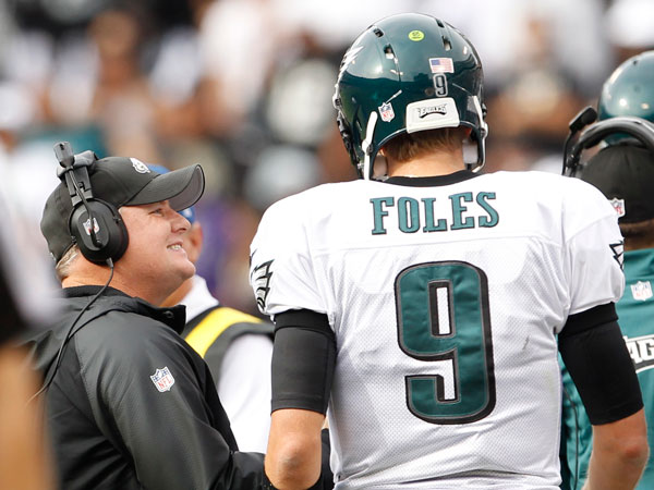 Chip Kelly and Nick Foles. (Ron Cortes/Staff Photographer)