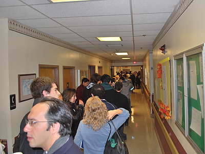Voters stand in line to cast ballots in the 3rd and 11th Divisions of the 27th Ward in University City. (Jonathan Tannenwald / Philly.com)