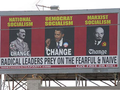 A billboard ordered and paid for by the North Iowa Tea Party shows President Barack Obama, Adolf Hitler, left and Vladimir Lenin, on South Federal Avenue in Mason City, Iowa, July 12, 2010. (AP Photo/Globe Gazette, Deb Nicklay)