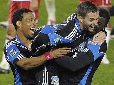 Bobby Convey (center) celebrates with teammates after San Jose knocked New York out of the MLS Cup playoffs. (Bill Kostroun/AP)