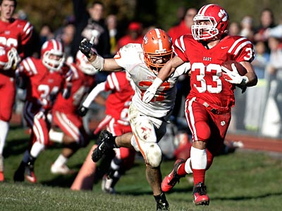 Cherry Hill East´s Brian Regan tries to elude Cherokee´s Nicholas Follet in the fourth quarter. (Elizabeth Robertson/Staff Photographer)