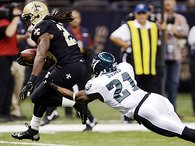 New Orleans Saints running back Chris Ivory (29) eludes Philadelphia Eagles defensive back David Sims (21) during the first half of an NFL football game at Mercedes-Benz Superdome in New Orleans, Monday, Nov. 5, 2012. (AP Photo/Bill Feig)