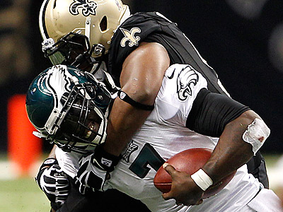 New Orleans Saints defensive end Will Smith (91) sacks Philadelphia Eagles quarterback Michael Vick (7) during the fourth quarter of their game on Monday, November 5, 2012. (Yong Kim/Staff Photographer)