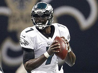 Michael Vick looks to pass the ball during the first quarter of their game against the Saints. (Ron Cortes/Staff Photographer)