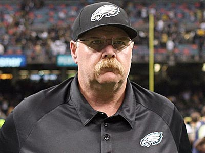 Andy Reid leaves the field after losing to the New Orleans Saints. (Yong Kim/Staff Photographer)