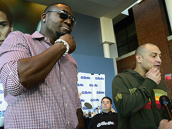 Newly shaved David Ortiz and Shane Victorino admire their clean faces.