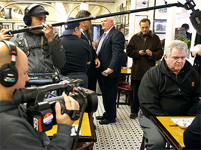 A camera crew hovers around U.S. Rep. Bob Brady Tuesday at Famous 4th Street Deli.