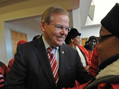NJ Senator Bob Menendez, at Delaware Valley Baptist Church in Willingboro, shakes hands with supporter Charlene Ayres-Britt of Lumberton, NJ. on Nov. 6, 2012, APRIL SAUL / Staff Photographer