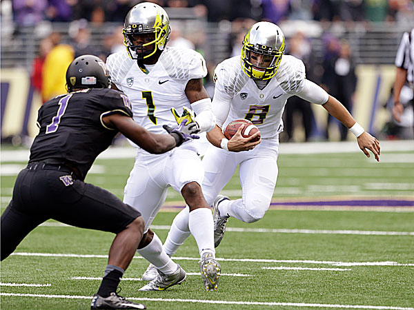 Oregon quarterback Marcus Mariota. (Elaine Thompson/AP)