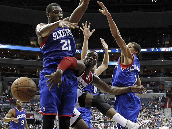 Wizards guard John Wall (2) is defended by 76ers forward Thaddeus Young (21), center Spencer Hawes (00), and guard Michael Carter-Williams (1). (Alex Brandon/AP)