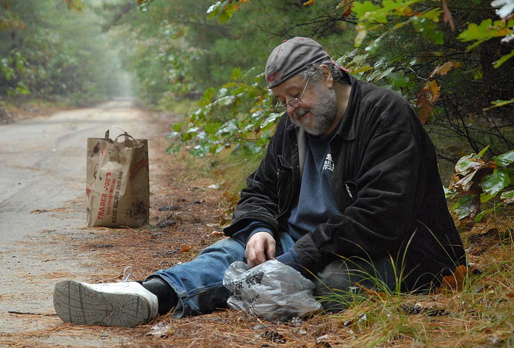 Seated somewhere in the Pine Barrens, amateur mycologist Felix Giordano adds to the stash of Slipper Jack mushrooms he´s been finding all around him. (Photo: Michèle Frentrop / For the Daily News)
