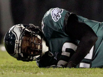 """Asante Samuel lies on the field after suffering a """"groin laceration"""" in Monday´s game. (David Maialetti/Staff Photographer)"""