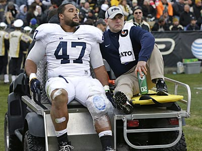 Penn State´s Jordan Hill is carted off the field after getting injured during the first half of an NCAA college football game against Purdue Saturday, Nov. 3, 2012, in West Lafayette, Ind. (AP Photo/Darron Cummings)