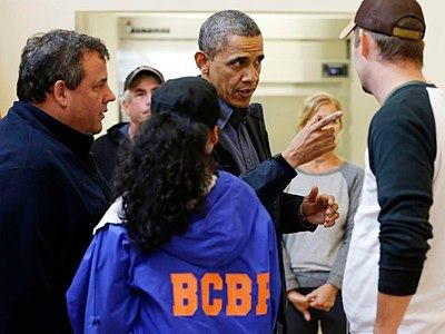 President Barack Obama, accompanied by New Jersey Gov. Chris Christie meets with local residents at the Brigantine Beach Community Center in Brigantine, NJ., Wednesday, Oct. 31, 2012. (AP Photo/Pablo Martinez Monsivais)