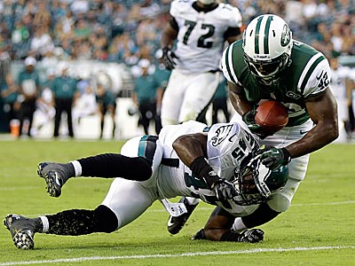 Phillip Thomas makes a tackle during a preseason game against the Jets. (Matt Rourke/AP)
