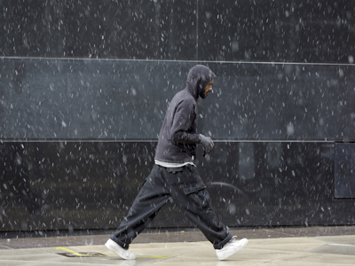A pedestrian walks along Broad Street through a winter storm, Wednesday, Nov. 7, 2012, in Philadelphia. (AP Photo/Matt Slocum)
