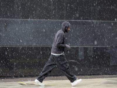 A pedestrian walks along Broad Street through a winter storm, Wednesday, Nov. 7, 2012, in Philadelphia. (AP Photo/Matt Slocum)