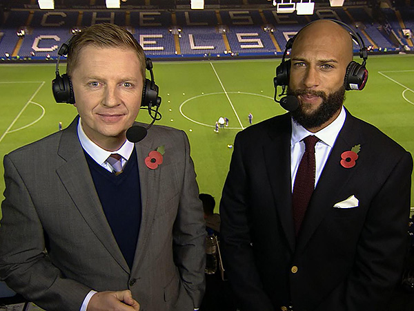 Arlo White and U.S. national team goalkeeper Tim Howard in the television gantry at Stamford Bridge, where they called the Chelsea-Manchester City game together. (Photo courtesy NBC Sports Group)