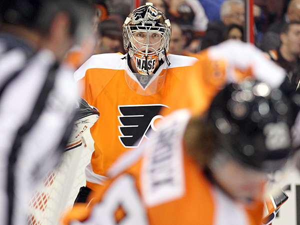 Flyers goalie Steve Mason watches a face-off. (Yong Kim/Staff Photographer)