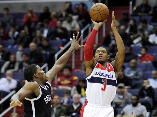 Washington Wizards guard Bradley Beal (3) puts up a shot over Brooklyn Nets guard Joe Johnson, left, during the second half of an NBA basketball game Friday, Nov. 8, 2013, in Washington. The Wizards won 112-108 in overtime. (Nick Wass/AP)