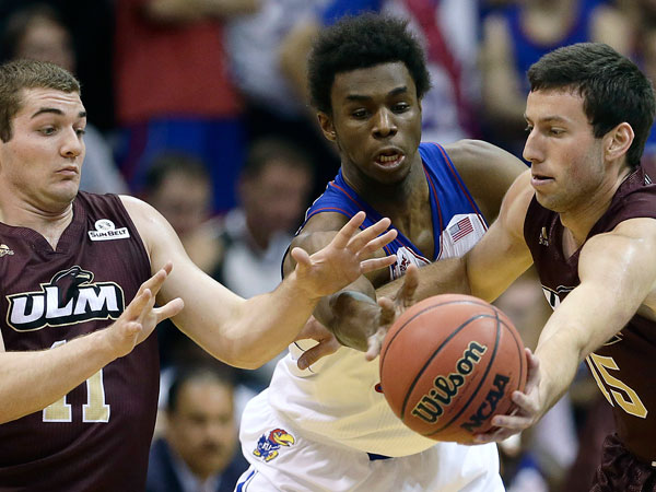 Kansas´ Andrew Wiggins, center, breaks up a pass between Louisiana Monroe´s Kyle Koszuta (15) and Nick Coppola (11) during the first half of an NCAA college basketball game on Friday, Nov. 8, 2013, in Lawrence, Kan. (Charlie Riedel/AP)