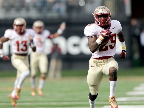 Florida State defensive back Nate Andrews (29) runs back an interception for a touchdown against Wake Forest in the first half of an NCAA college football game in Winston-Salem, N.C., Saturday, Nov. 9, 2013. (Nell Redmond/AP)