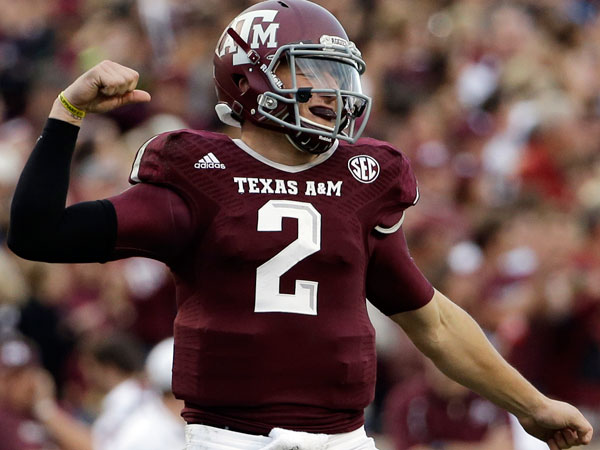 Texas A&M quarterback Johnny Manziel (2) celebrates after throwing a touchdown pass to Malcome Kennedy during the third quarter of an NCAA college football game against Mississippi State Saturday, Nov. 9, 2013, in College Station, Texas. (David J. Phillip/AP)
