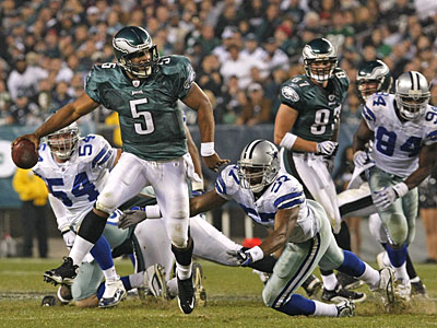 Donovan McNabb scrambles but could not get a first down as he<br />his tackled by Cowboys Victor Butler in fourth quarter, eagles settled<br />for a field goal on this drive, on Sunday.  (Ron Cortes / Staff Photographer)