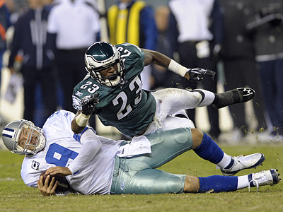 Dominique Rodgers-Cromartie stops Dallas quarterback Tony Romo. (AP Photo/Michael Perez)