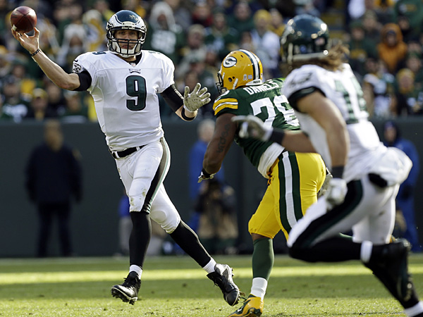 Eagles quarterback Nick Foles throws to Riley Cooper during the first half against the Packers. (Mike Roemer/AP)