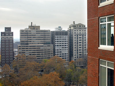 A guest (in window at far right) at yesterday´s opening takes in the view at 10 Rittenhouse Square. (Tom Gralish / Staff)