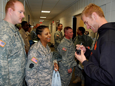 Flyers forward Jeff Carter signs a puck for Staff Sgt. Patricia Hodge after practice yesterday. The Flyers got a visit from troops stationed at Fort Dix in observance of Veterans Day. (Zack Hill)<br />