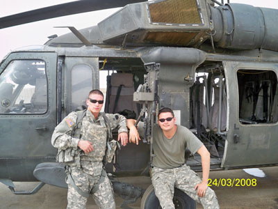 Nick Miccarelli III (right) had been just sworn in as Delco state representative when he was deployed to Iraq. Here he is with his chopper and Lt. Mark Martella in Basara.