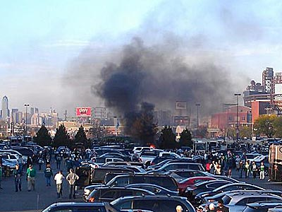 Something appears to be on fire in the parking lot outside Lincoln Financial Field. (Photo tweeted by @MarisaMagnatta)
