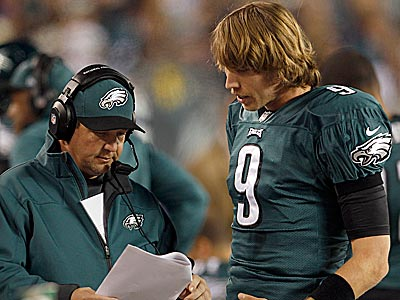 Eagles quarterback Nick Foles and offensive coordinator Marty Mornhinweg talk over plays on the sidelines. (Yong Kim/Staff Photographer)