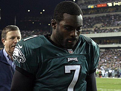 Eagles quarterback Michael Vick leaves the field after suffering a concussion against the Cowboys. (Yong Kim/Staff Photographer)