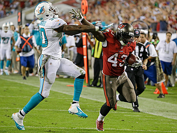 Buccaneers running back Bobby Rainey is pushed out of bounds by Dolphins strong safety Chris Clemons during the fourth quarter. (John Raoux/AP)