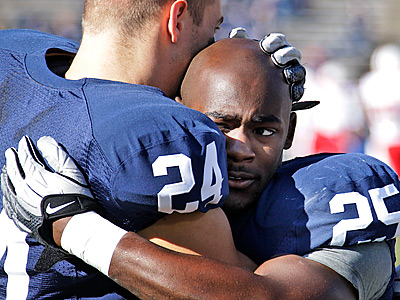 Penn State running backs Derek Day (24) and Silas Redd (25) embrace during warm ups. (AP Photo/Gene J. Puskar)