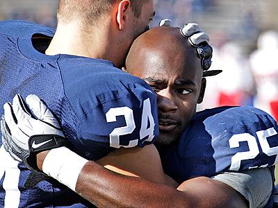 Penn State running backs Derek Day (24) and Silas Redd (25) embrace during warm ups. (AP Photo/Gene J. Puskar)