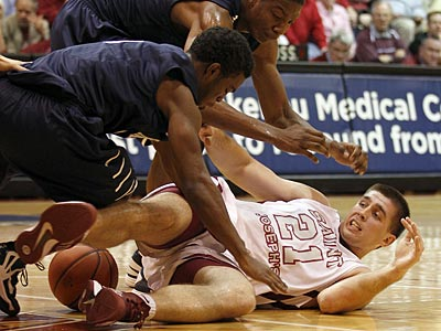 Saint Joseph´s Halil Kanacevic (right) hits the court against Yale´s Brandon Sherrod (center) and Michael Grace during the first half on Monday, November 12, 2012. (Yong Kim/Staff Photographer)
