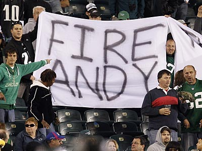 Fans hold up a sign as head coach Andy Reid, foreground, works the<br />sidelines during the 4th quarter. Philadelphia Eagles lose 38-23 to<br />the Dallas Cowboys at Lincoln Financial Field in Philadelphia on<br />November 11, 2012. (David Maialetti/Staff Photographer)