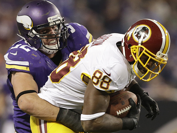 Washington Redskins wide receiver Pierre Garcon, right, is tackled by Minnesota Vikings linebacker Chad Greenway (52). (AP Photo/Jim Mone)