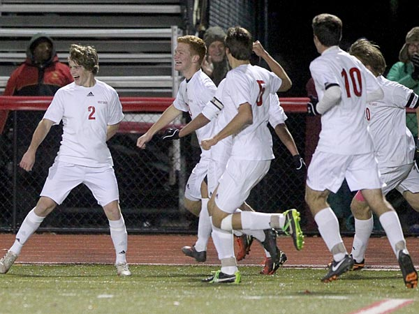 Michael Kirby, left, of Holy Ghost Prep celebrates a 2013 goal with teammates. (Charles Fox/Staff Photographer)