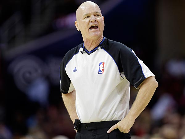 Referee Joe Crawford barks at the Indiana Pacers bench during a preseason NBA basketball game against the Cleveland Cavaliers Saturday, Oct. 19, 2013, in Cleveland. (AP Photo/Mark Duncan)