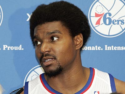 "76ers center Andrew Bynum said, ""It's the same exact injury, mirror images of the knee; I think it happened bowling, to be honest."" (Tom Mihalek/AP)"