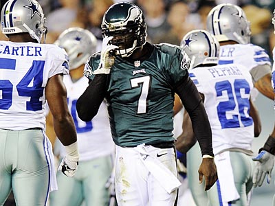 Michael Vick is progressing in his concussion recovery, but will miss Monday´s game. (Michael Perez/AP)