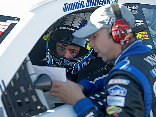 Jimmie Johnson listens to crew chief Chad Knaus. (Nell Redmond/AP)