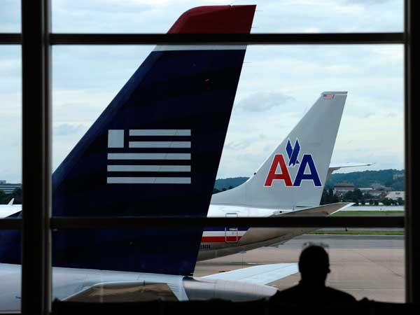 The U.S. Department of Justice has cleared a merger between American Airlines and US Airways. (AP photo)