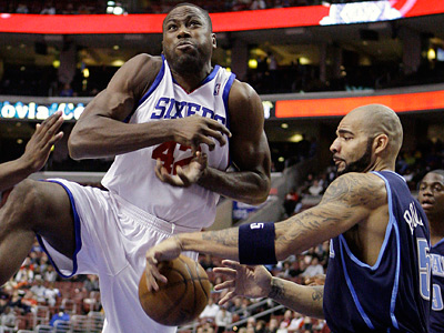 Elton Brand has the ball stripped by Jazz forward Carlos Boozer during Utah´s 112-90 win on Nov 13. (AP Photo/Matt Slocum)